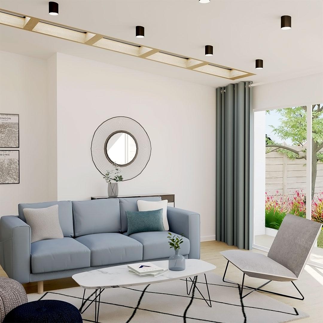Extension-de-salon-bleu-scandinave-vers-le-jardin-avec-fenetre-en-velux-sur-le-toit-maisonetvous