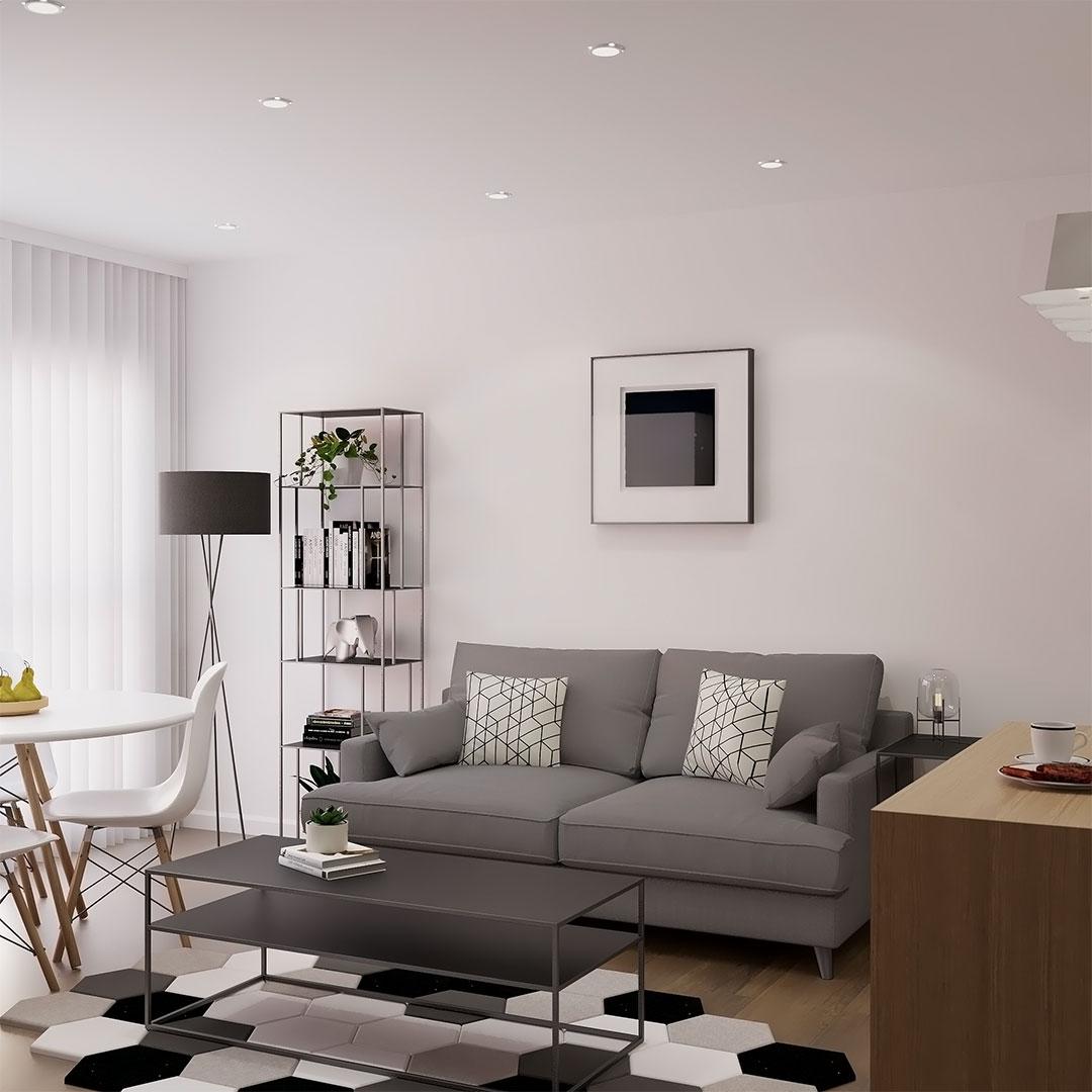 Rénovation-d'appartement-à-Lille,-salon-blanc-avec-canapé-gris,-spots-fauxplafond---Maison-&-Vous