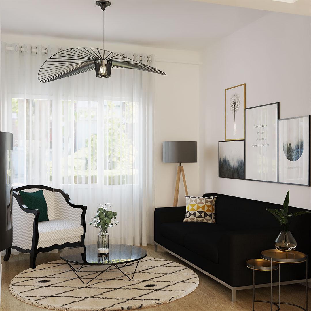 Rénovation de maison, sur la photo le salon avec le canapé noir et les mobiliers en noir et blanc - maisonetvous